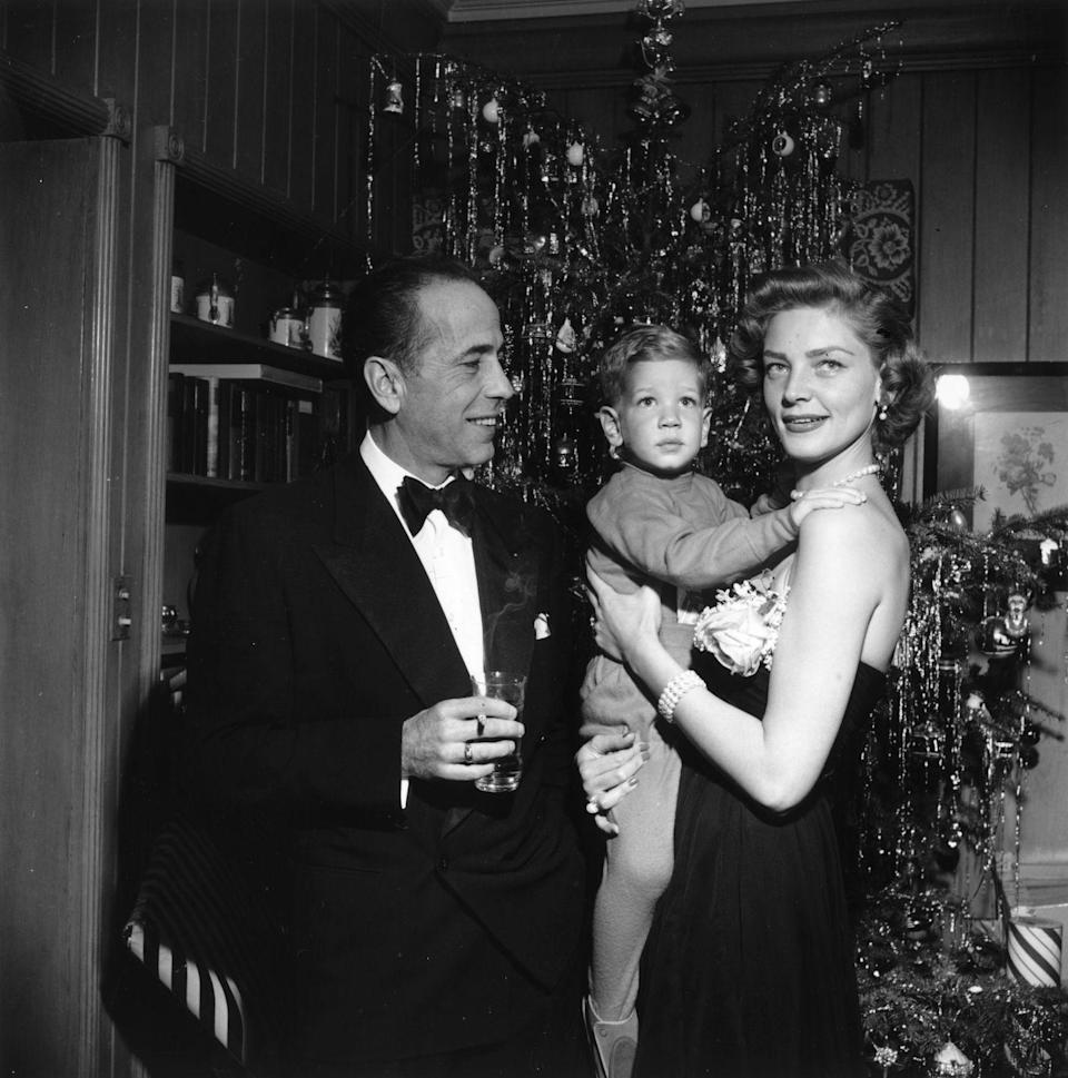 <p>The husband-wife duo poses with their son in front of a decked-out Christmas tree in 1951.</p>