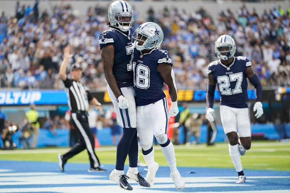 Dallas Cowboys strong safety Damontae Kazee, center right, celebrates with Trevon Diggs (7) after intercepting a pass during the second half of an NFL football game against the Los Angeles Chargers Sunday, Sept. 19, 2021, in Inglewood, Calif.