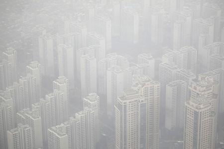 Apartment complexes are seen shrouded by fine dust during a polluted day in Seoul