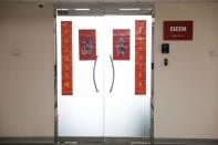 A placard with the BBC logo is seen outside their bureau in Beijing