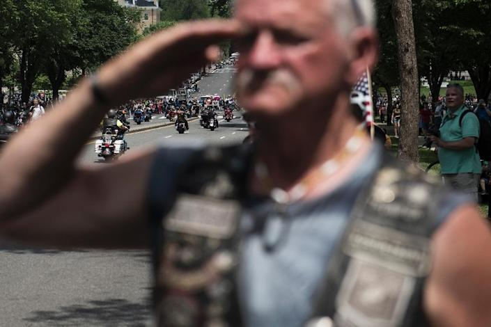 """A US veteran salutes as thousands of bikers and military veterans take part in the annual """"Rolling Thunder Ride for Freedom"""" motorcycle parade in Washington (AFP Photo/Eric BARADAT)"""