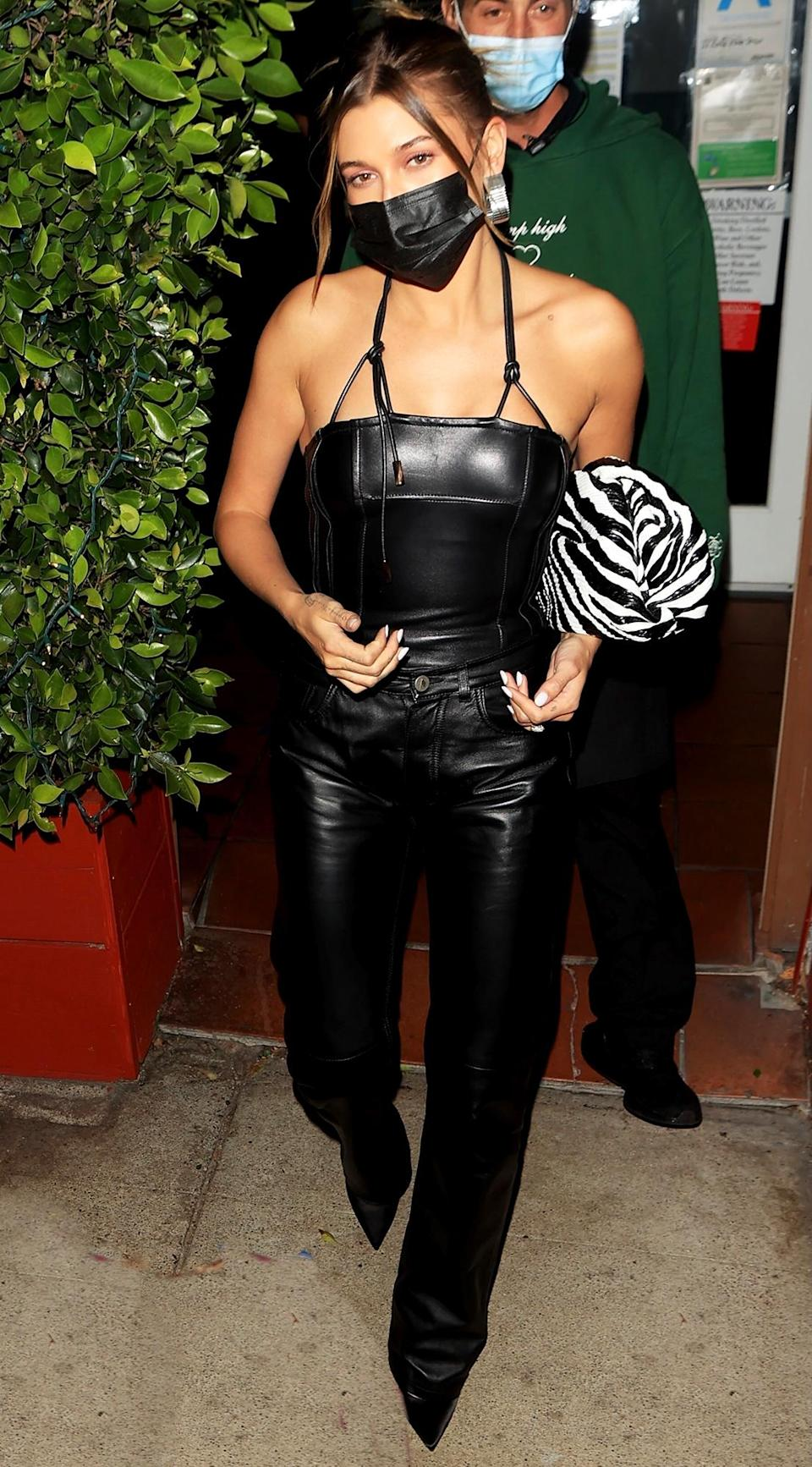 <p>Hailey Bieber looked stylish in an all-black leather outfit while enjoying dinner with friends at Giorgio Baldi in Santa Monica, California.</p>