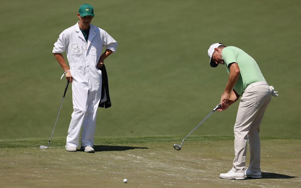 Lee Westwood of England putts as his caddie and son Sam Westwood - Getty Images