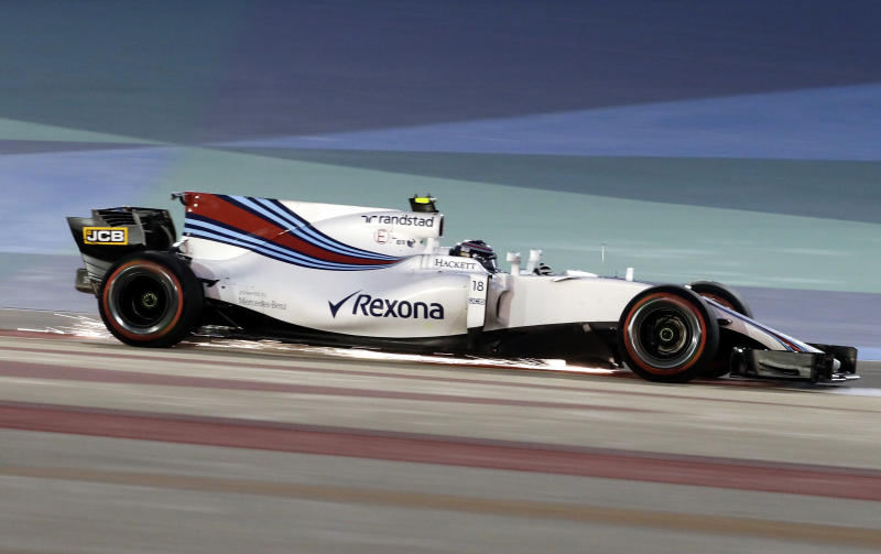 Sparks fly off the car of Williams driver Lance Stroll of Canada during the qualifying session for the Bahrain Formula One Grand Prix, at the Formula One Bahrain International Circuit in Sakhir, Bahrain, Saturday, April 15, 2017. The Bahrain Formula One Grand Prix will take place on Sunday. (AP Photo/Luca Bruno)