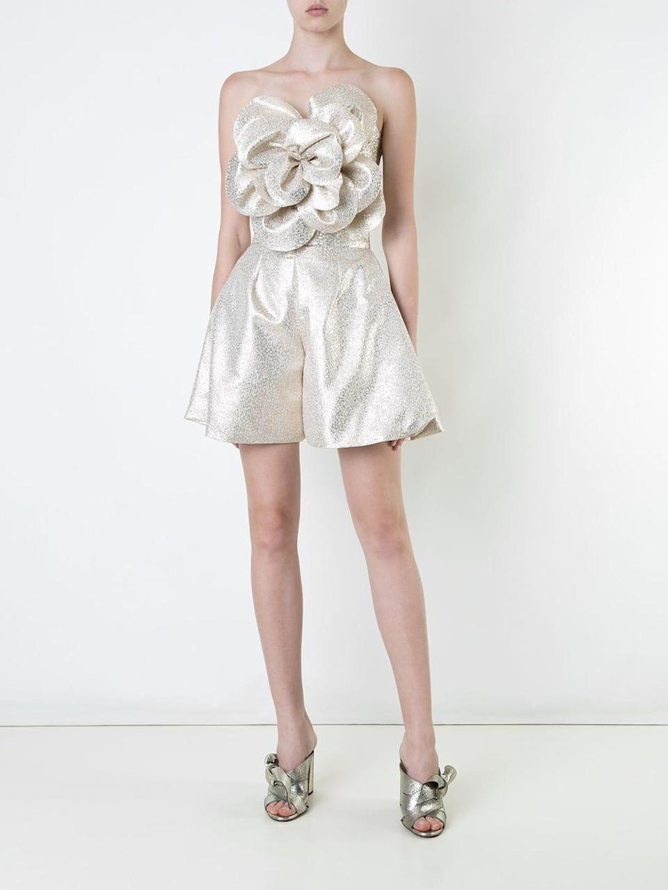 """<h2>Anytime Metallics</h2><br><br>""""The Roaring '20s 2.0 is on everyone's lips, and fittingly metallics are having a major moment — from sequins and glittering paillettes to Glomesh mesh to shiny Lurex. Where sparkle traditionally emerged after twilight, it now qualifies a perfectly acceptable choice with denim for a bodega run. Anything in the interest of sparking joy!""""<br><br> - Celenie Seidel, Senior Womenswear Editor at Farfetch<br><br><strong>Bambah</strong> Glitter Pleated Culottes, $, available at <a href=""""https://go.skimresources.com/?id=30283X879131&url=https%3A%2F%2Fwww.farfetch.com%2Fshopping%2Fwomen%2Fbambah-glitter-pleated-culottes-item-12118911.aspx%3Fstoreid%3D10735"""" rel=""""nofollow noopener"""" target=""""_blank"""" data-ylk=""""slk:Farfetch"""" class=""""link rapid-noclick-resp"""">Farfetch</a>"""