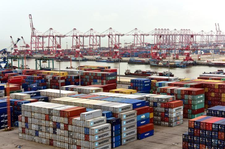 Shipping containers are seen at Nansha terminal of Guangzhou port, in Guangdong