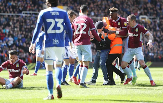 A Birmingham City supporter has been sentenced to prison and banned for life following his pitch invasion over the weekend, during which he punched Aston Villa's Jack Grealish. (Getty)