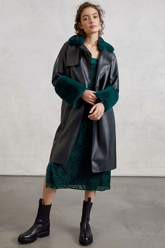 """<br><br><strong>BLANKNYC</strong> Sonya Faux Leather Trench Coat, $, available at <a href=""""https://go.skimresources.com/?id=30283X879131&url=https%3A%2F%2Fwww.blanknyc.com%2Fproducts%2Fpu-trench-with-faux-fur-trim-77es5303-jaded"""" rel=""""nofollow noopener"""" target=""""_blank"""" data-ylk=""""slk:BlankNYC"""" class=""""link rapid-noclick-resp"""">BlankNYC</a>"""