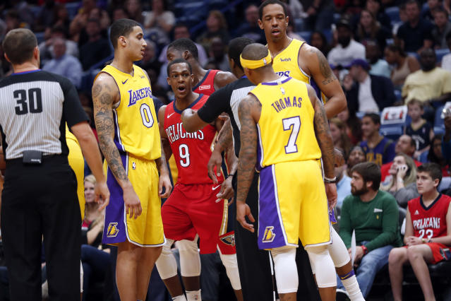 Rajon Rondo (9) and  Isaiah Thomas (7) are separated by an official. (AP)