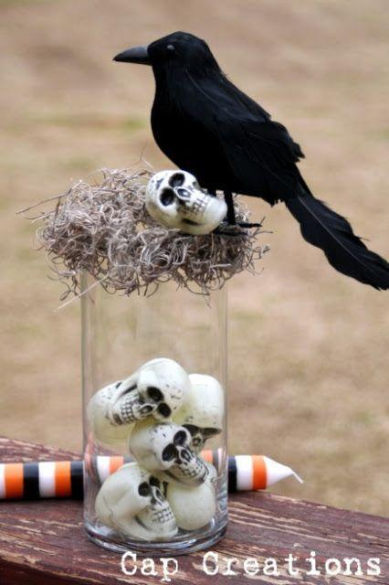 """<p>Crows and skulls and moss, oh my! Use a leftover vase to whip up this moody centerpiece in no time, and consider making multiple—the more creepy crows around the house, the scarier. </p><p><strong>Get the tutorial at <a href=""""http://blog.capscreations.com/2010/10/dollar-store-halloween-decor.html"""" rel=""""nofollow noopener"""" target=""""_blank"""" data-ylk=""""slk:Cap Creations"""" class=""""link rapid-noclick-resp"""">Cap Creations</a>. </strong> </p>"""