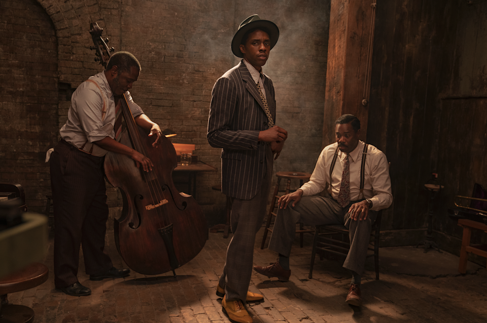 """Chadwick Boseman, center, stars as Levee in """"Ma Rainey's Black Bottom."""" Michael Potts, left, plays Slow Drag and Colman Domingo, right, is Cutler."""