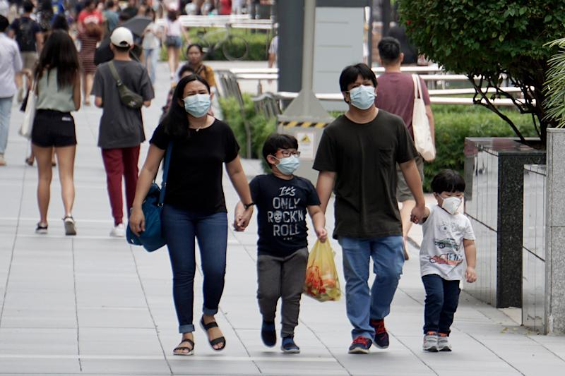 A family wearing face masks seen in Orchard Road on 21 March 2020. (PHOTO: Dhany Osman / Yahoo News Singapore)