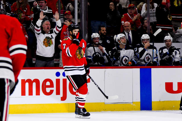 Chicago Blackhawks defenseman Brent Seabrook (7) celebrates after he scores against the Winnipeg Jets during the first period of an NHL hockey game Saturday, Oct. 12, 2019, in Chicago. (AP Photo/Matt Marton)
