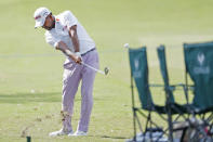 Anirban Lahiri, of India, hits over a set of chairs along the first fairway rough during the second round of the Sanderson Farms Championship golf tournament in Jackson, Miss., Friday, Sept. 20, 2019. (AP Photo/Rogelio V. Solis)