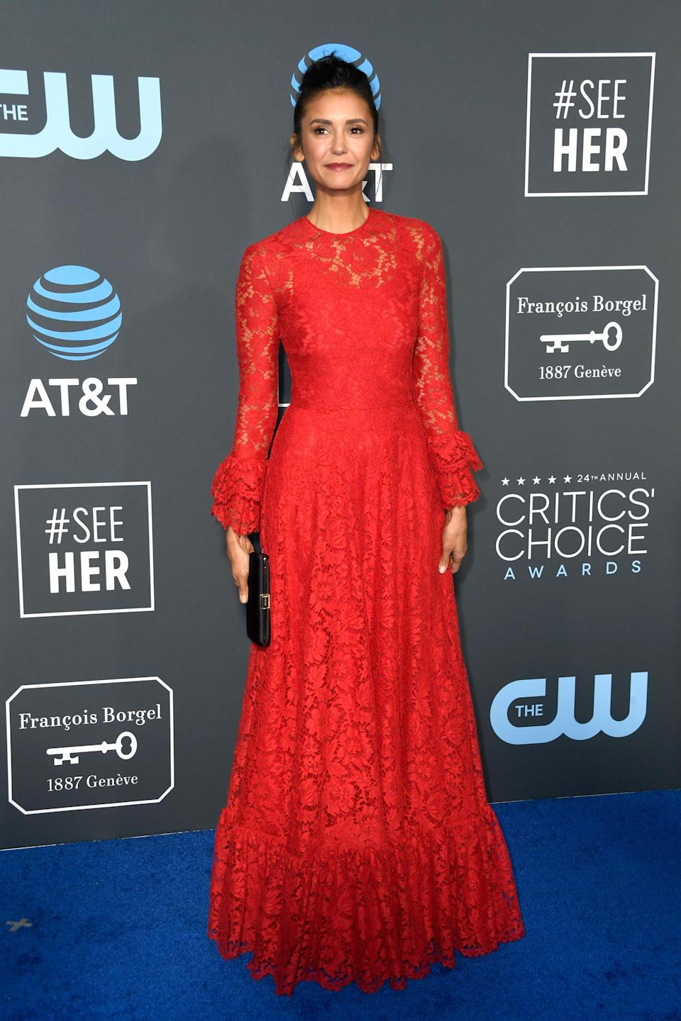 <p>The Vampire Diaries star Nina Dobrev wowwed in a red lace gown. Source: Getty </p>