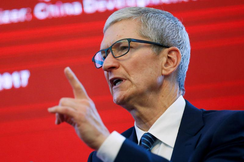FILE PHOTO: Apple CEO Tim Cook attends the China Development Forum in Beijing