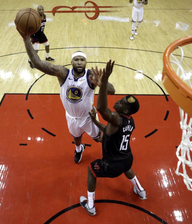 Golden State Warriors' DeMarcus Cousins (0) shoots as Houston Rockets' Clint Capela (15) defends during the second half of an NBA basketball game, Wednesday, March 13, 2019, in Houston. The Warriors won 106-104. (AP Photo/David J. Phillip)