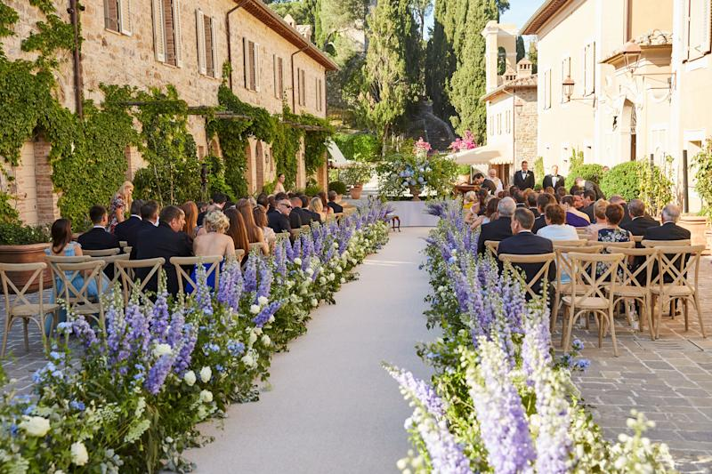 It ran through the center of Castiglion del Bosco, a departure from the estate's typical ceremony location (they're usually held either in the ruins or overlooking the hills). Event planner Alex Fitzgibbons felt an aisle the length of the stone pathway provided the most dramatic entrance for the bride.