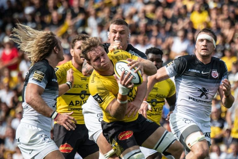 South African flanker Wiaan Liebenberg (R) collected one of La Rochelle's three tries against Toulouse