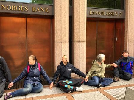 Extinction Rebellion climate activists block Norway's Central Bank entrance in Oslo, Norway May 24, 2019. REUTERS/Nerijus Adomaitis