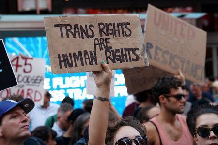 FILE PHOTO: People protest U.S. President Donald Trump's announcement that he plans to reinstate a ban on transgender individuals from serving in any capacity in the U.S. military, in Times Square, in New York City, New York, U.S., July 26, 2017. REUTERS/Carlo Allegri/File Photo