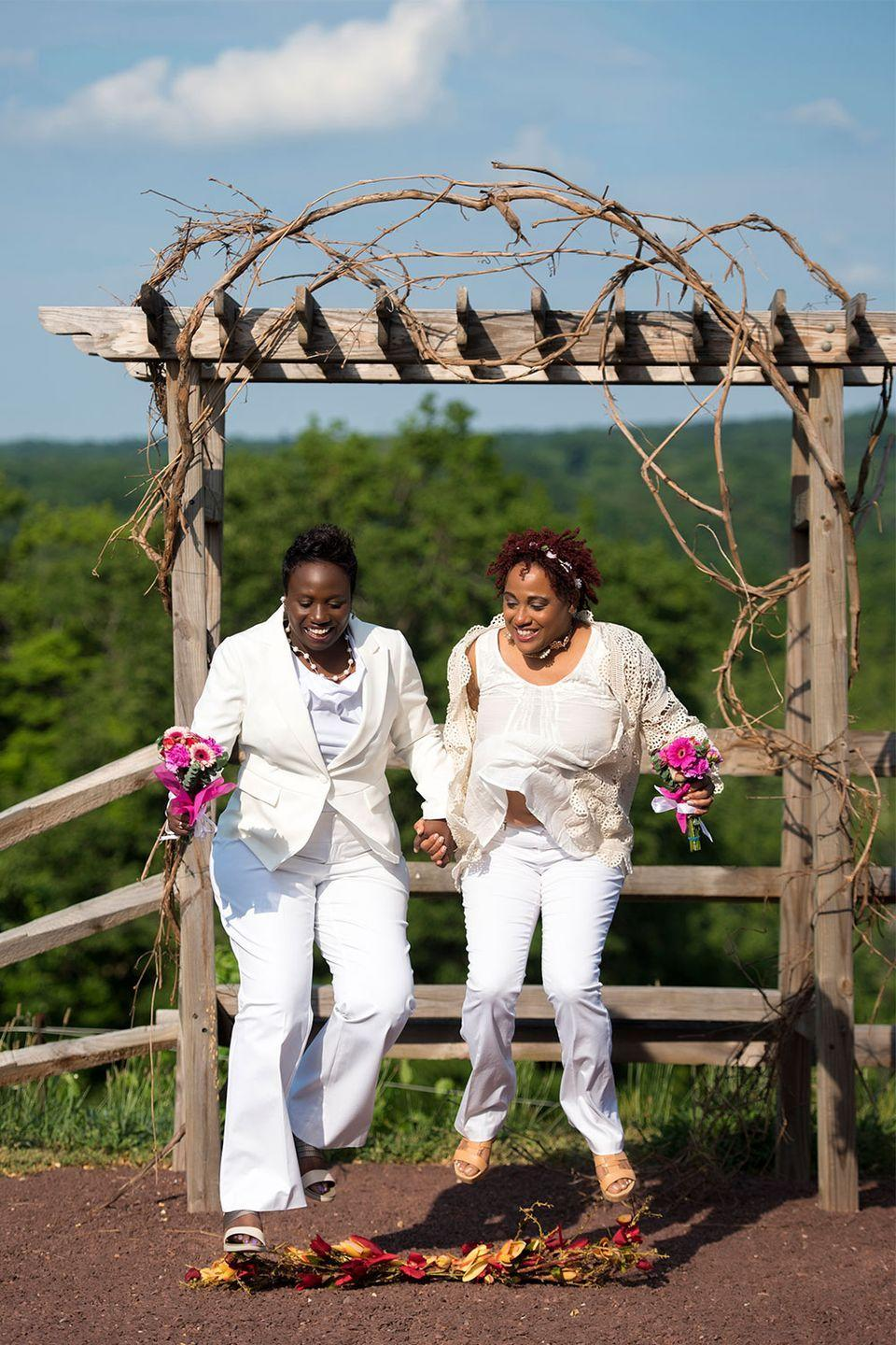 """<p>Marci and Tracey jumped the broom on June 24, 2016. """"Thinking about our day, the broom represented our leap of faith to choose each other, to choose love and to commit to our amazing journey,"""" they said.</p>"""