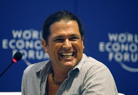 Colombian singer Vives laughs during the Music For Social Change forum at the World Economic Forum on Latin America in Cartagena