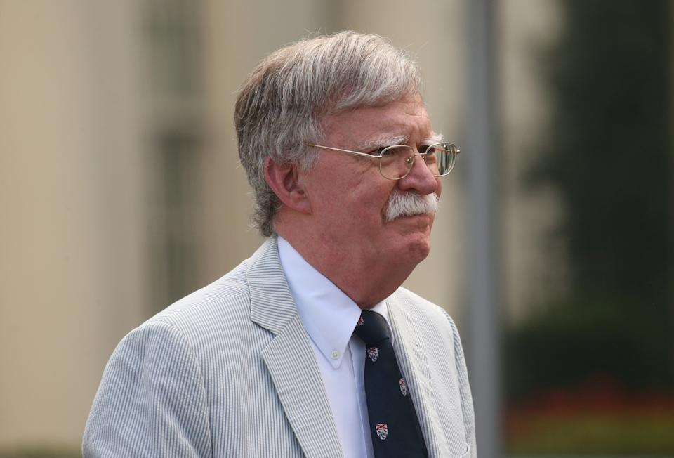 U.S. National Security Adviser John Bolton walks to give an interview to Fox News outside of the White House in Washington, U.S. July 31, 2019. REUTERS/Leah Millis