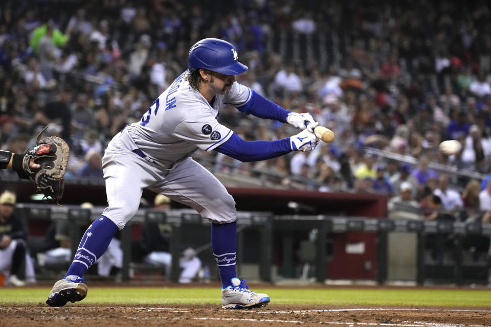 Los Angeles Dodgers' Tony Gonsolin lays down a sacrifice bunt against the Arizona Diamondbacks in the fifth inning during a baseball game, Friday, Sept. 24, 2021, in Phoenix. (AP Photo/Rick Scuteri)