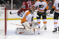 Philadelphia Flyers goaltender Carter Hart makes a save during the second period of the team's NHL hockey game against the New Jersey Devils in Newark, N.J., Friday, Nov. 1, 2019. (AP Photo/Seth Wenig)