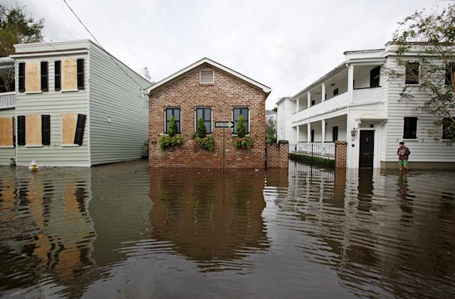 <p>Flood waters rise up to homes in an affluent historic neighborhood after Hurricane Matthew hit Charleston, S.C., on Oct. 8, 2016. (Photo: Jonathan Drake/Reuters) </p>
