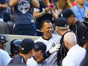 Rodriguez's teammates congratulated him on his latest milestone. (Getty Images)