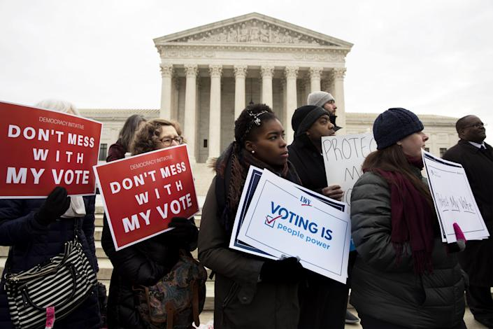 Voting rights advocates rally outside the Supreme Court as the court hears oral arguments in Husted v. A. Philip Randolph Institute case in Washington, D.C., in January. (Photo: Michael Reynolds/EPA-EFE/REX/Shutterstock)