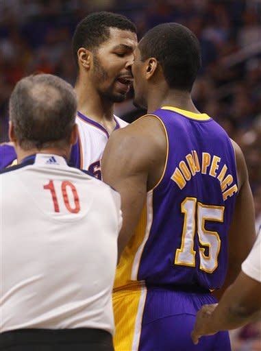 Los Angeles Lakers' Metta World Peace (15) and Phoneix Suns' Markieff Morris exchange words during the first half of an NBA basketball game, Saturday, April 7, 2012, in Phoenix. (AP Photo/Matt York)