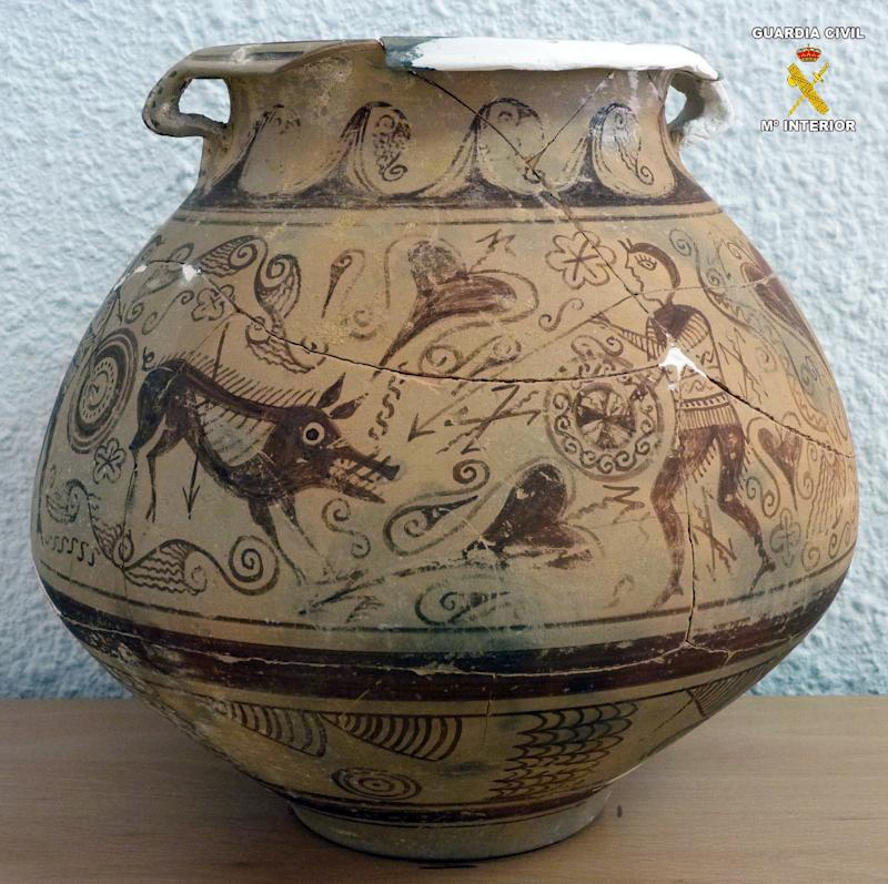 In this picture released by the Spanish Interior Ministry on Saturday, Jan. 5, 2013,  a very rare vase from late second century BC that was seized by police after it was found in an antique shop in the town of El Campello, eastern Spain.  Officers seized the object during a routine inspection and arrested the shop owner for allegedly receiving and handling the plundered antiquity of almost incalculable historical importance.  The vase is nearly 22-centuries old and was allegedly taken from an Iberian era archeological site in the Spanish province of Alicante. (AP Photo/Interior Ministry) Eds note: Logo at top right put on by source.