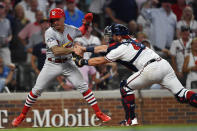 Atlanta Braves catcher Francisco Cervelli (45) tags out St. Louis Cardinals second baseman Kolten Wong (16) in the eighth inning during Game 1 of a best-of-five National League Division Series, Thursday, Oct. 3, 2019, in Atlanta. (AP Photo/John Amis)