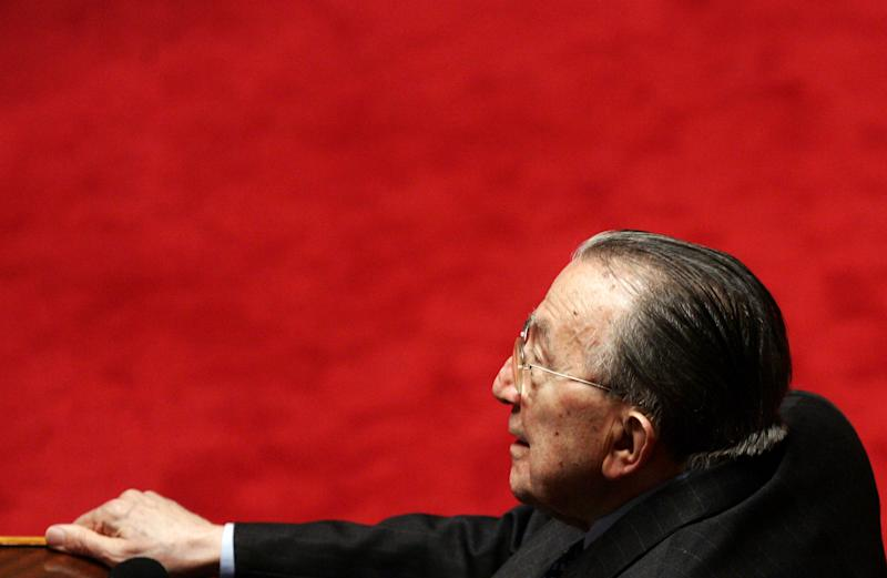 FILE - In this Saturday April 29, 2006 file photo, former Italian Premier and center right candidate to the Senate presidency Giulio Andreotti sits at the Senate in Rome.Italian state television says Giulio Andreotti, Italy's former seven-time premier, has died at age 94. At his prime, Andreotti was one of Italy's most powerful men: he helped draft the country's constitution after World War II, sat in parliament for 60 years and served as premier seven times. Andreotti was hospitalized last year with heart problems stemming from a respiratory infection. (AP Photo/Plinio Lepri, File)