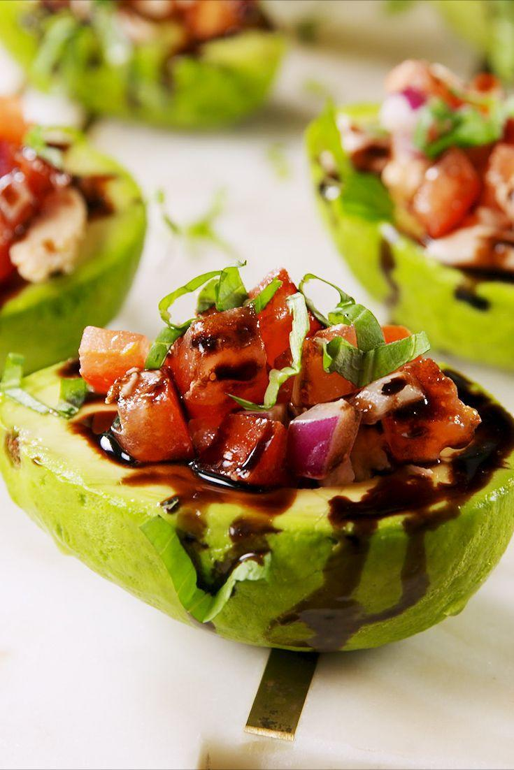 "<p>Guilt-free and so pretty.</p><p>Get the recipe from <a href=""https://www.delish.com/cooking/recipe-ideas/a22110065/bruschetta-chicken-stuffed-avocados-recipe/"" rel=""nofollow noopener"" target=""_blank"" data-ylk=""slk:Delish."" class=""link rapid-noclick-resp"">Delish.</a> </p>"