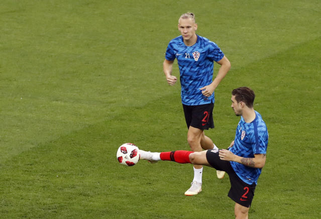 Croatia's Sime Vrsaljko, right, kicks the ball in front of Domagoj Vida during warmup before the semifinal match between Croatia and England at the 2018 soccer World Cup in the Luzhniki Stadium in Moscow, Russia, Wednesday, July 11, 2018. (AP Photo/Darko Bandic)