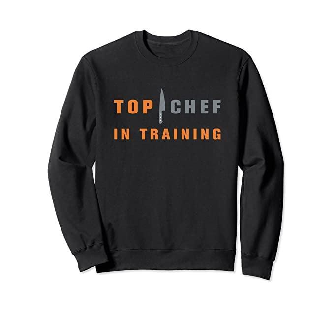 <p><span>Top Chef In Training Crew Neck Sweatshirt</span> ($45) will make those stay-at-home cooking nights fun.</p>