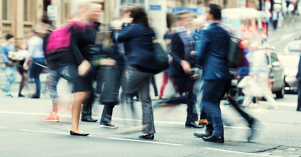 Blurred image of business people crossing the road