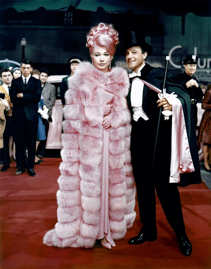 What a Way to Go!, 1964 Costume Designer: Edith Head Shirley MacLaine's well-dressed widow, Louisa May Foster, has more outfit changes than husbands in this 1964 film, which shows her in a gleeful wardrobe of Edith Head–designed gowns that aid in her many seductions. An under-the-radar gem, this dark comedy has all the right ingredients for campy fun.