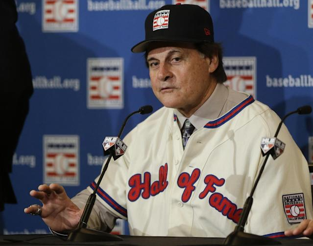 Tony La Russa answers questions at a news conference after it was announced that he, Bobby Cox, and Joe Torre were unanimously elected to the baseball Hall of Fame, at the MLB winter meetings in Lake Buena Vista, Fla., Monday, Dec. 9, 2013. Torre and Cox retired as managers after the 2010 season and La Russa after leading St. Louis to the 2011 championship. Torre won four World Series titles with the Yankees, La Russa three with Oakland and the Cardinals, and Cox one with Atlanta. (AP Photo/John Raoux)