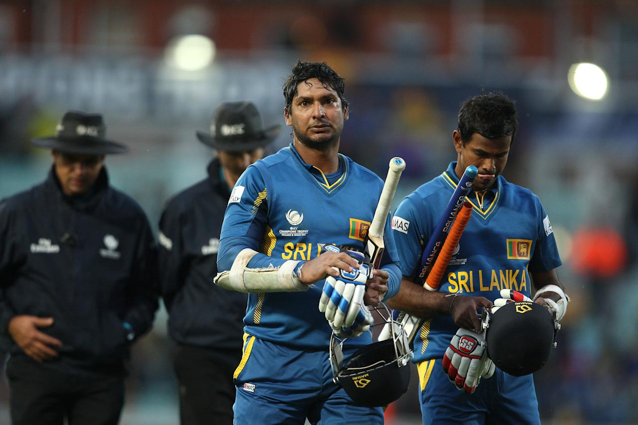 Sri Lanka's Kumar Sangakkara (left) and Nuwan Kulasekera leave the field after victory at the end of the ICC Champions Trophy match at The Kia Oval, London.
