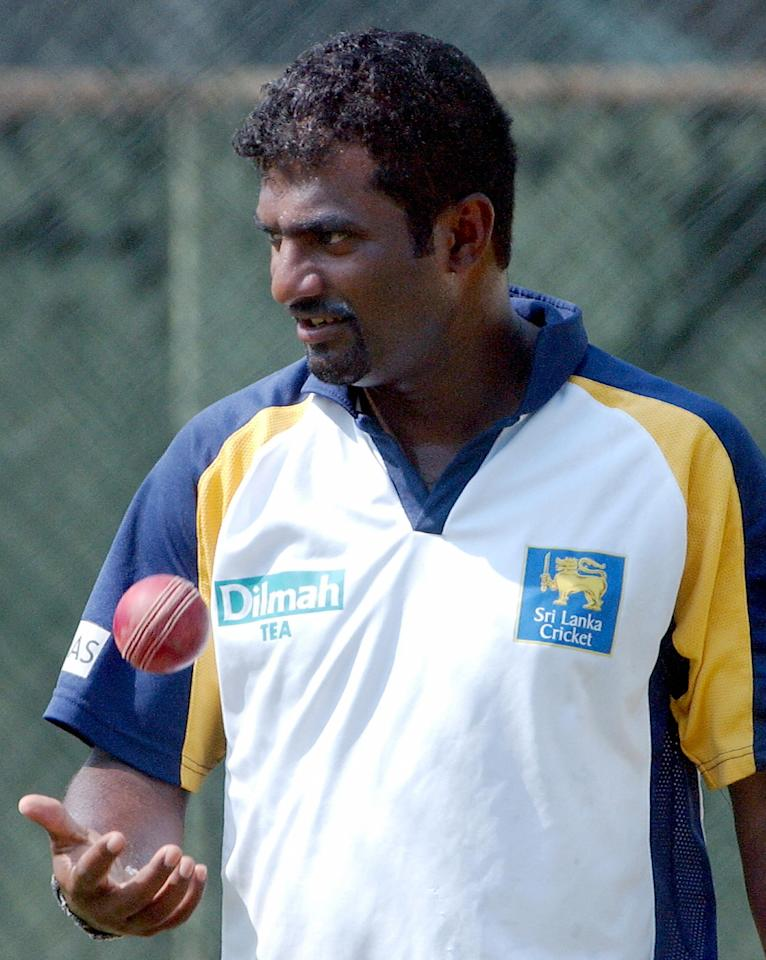 Colombo, SRI LANKA:  Sri Lankan cricketer Muttiah Muralitharan prepares to bowl during a practice session at The Sinhalese Sports Club (SSC) Ground in Colombo, 24 March 2006. The first Test match between Pakistan and Sri Lanka will begin 26 March at the SSC ground follwed by the second Test which will be held in Kandy from 03 April. AFP PHOTO/Sanka VIDANAGAMA  (Photo credit should read SANKA VIDANAGAMA/AFP/Getty Images)