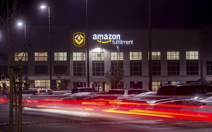 Employees arrive for work at an Amazon Fulfillment Center, ahead of the Christmas rush, in Tracy, California