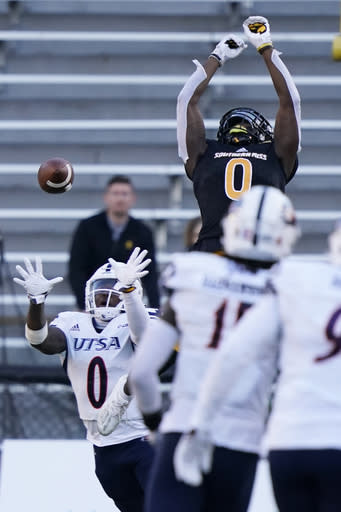UTSA safety Rashad Wisdom (0) intercepts a pass intended for Southern Mississippi wide receiver Demarcus Jones (0) during the second half of an NCAA college football game, Saturday, Nov. 21, 2020, in Hattiesburg, Miss. UTSA won 23-20. (AP Photo/Rogelio V. Solis)