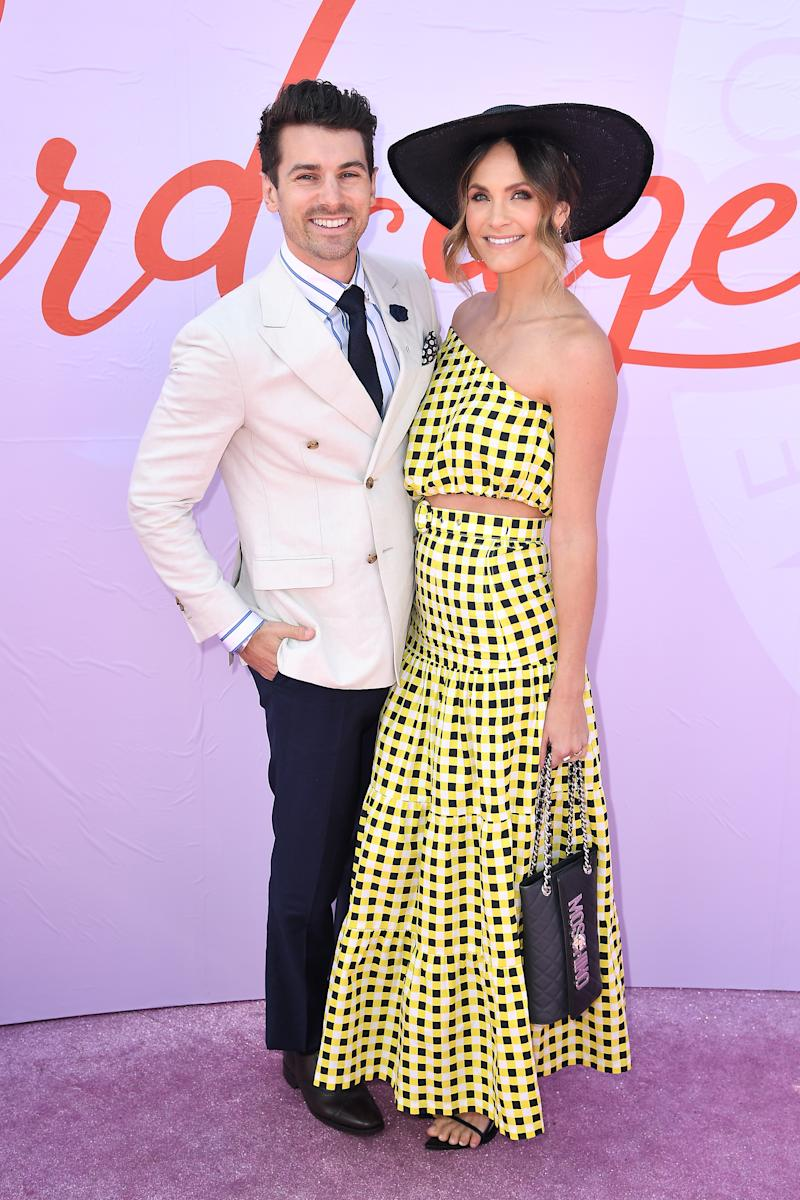 Matty Johnson and Laura Byrne attend Melbourne Cup Day at Flemington Racecourse on November 05, 2019 in Melbourne, Australia.