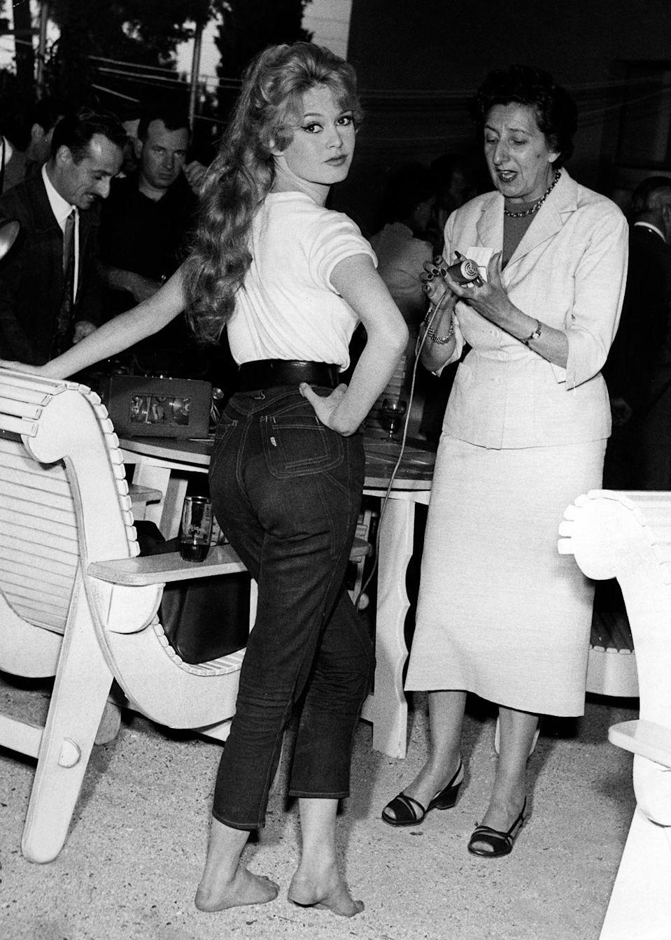 <p>Brigitte Bardot was among the first women unable to resist pairing jeans with a simple white T-shirt. Perfection. </p>