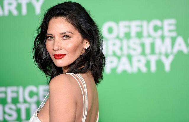 Olivia Munn flaunts her flawless skin at the <em>Office Christmas Party</em> premiere in Westwood, Calif. (Photo: Matt Winkelmeyer/Getty Images)
